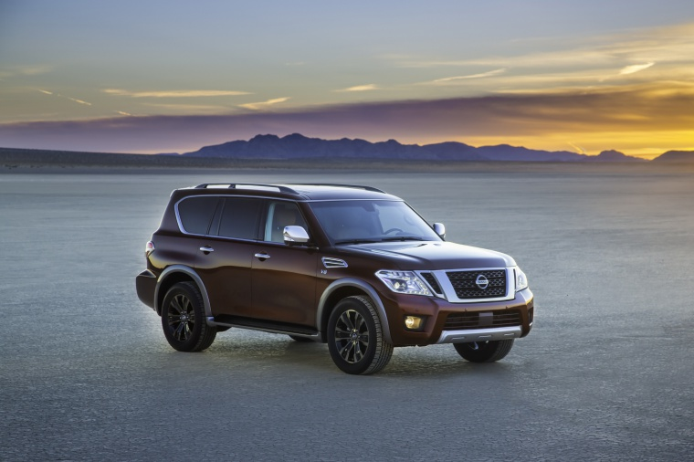 Picture of a 2020 Nissan Armada Platinum in Forged Copper Metallic from a front right three-quarter perspective