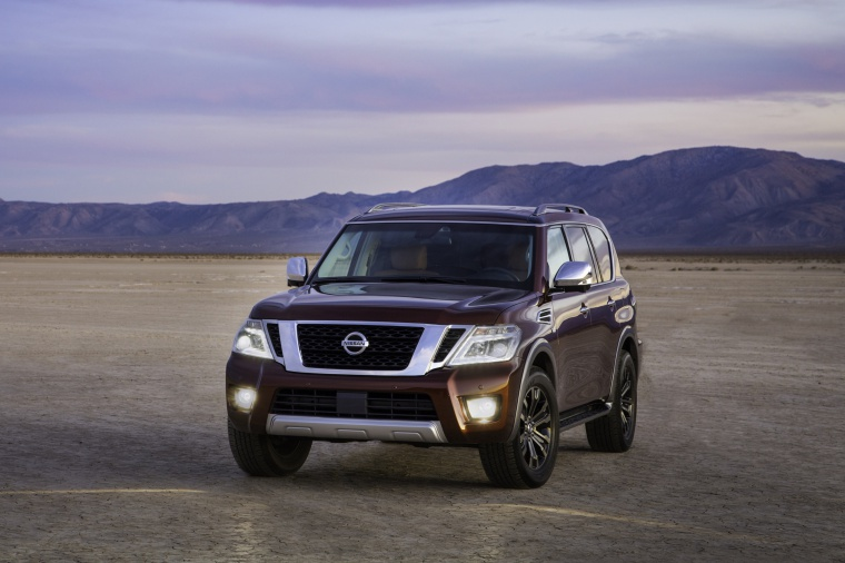 Picture of a 2020 Nissan Armada Platinum in Forged Copper Metallic from a front left perspective