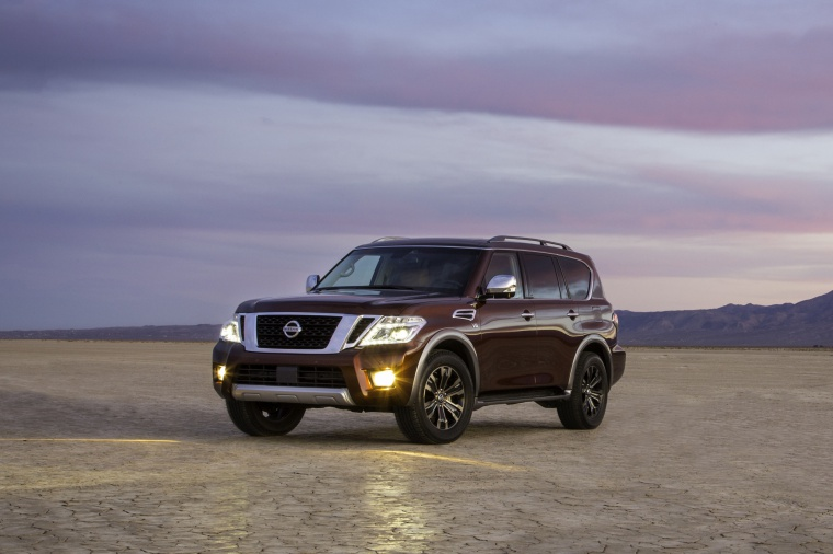 Picture of a 2020 Nissan Armada Platinum in Forged Copper Metallic from a front left three-quarter perspective