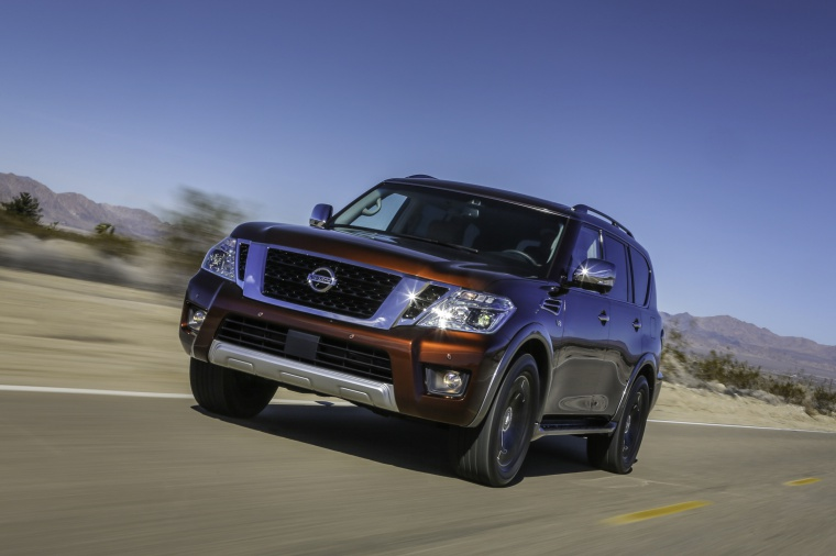 Picture of a driving 2020 Nissan Armada Platinum in Forged Copper Metallic from a front left perspective