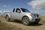 2011 Nissan Frontier King Cab PRO-4X 4WD in Radiant Silver - Driving Front Right Three-quarter View