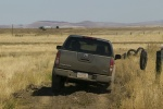 2014 Nissan Frontier Crew Cab PRO-4X 4WD in Night Armor - Driving Rear View
