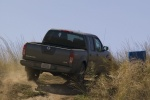 2014 Nissan Frontier Crew Cab PRO-4X 4WD in Night Armor - Driving Rear Right View