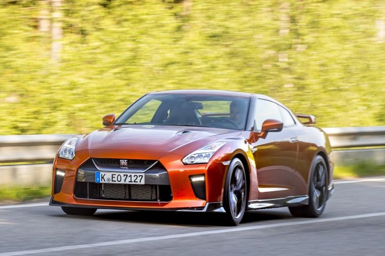 Driving 2017 Nissan GT-R Coupe Premium in Blaze Metallic from a front left three-quarter view