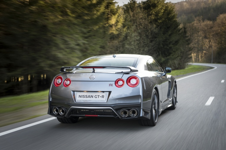 Driving 2017 Nissan GT-R Coupe Premium in Gun Metallic from a rear right view