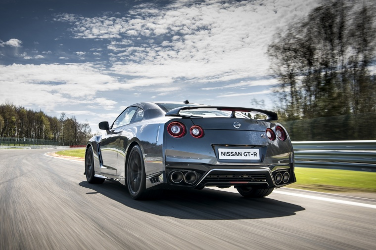 Driving 2017 Nissan GT-R Coupe Premium in Gun Metallic from a rear left view