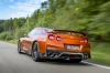 Driving 2017 Nissan GT-R Coupe Premium in Blaze Metallic from a rear left view