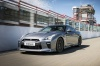 Driving 2017 Nissan GT-R Coupe Premium in Gun Metallic from a front left three-quarter view