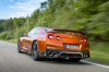 Driving 2018 Nissan GT-R Coupe Premium in Blaze Metallic from a rear left view