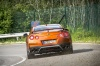 Driving 2018 Nissan GT-R Coupe Premium in Blaze Metallic from a rear view