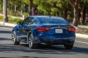 2016 Nissan Maxima SR Sedan in Deep Blue Pearl from a rear left three-quarter view