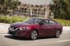 Driving 2017 Nissan Maxima Platinum Sedan in Coulis Red from a front left view