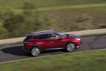 Picture of a driving 2017 Nissan Murano in Cayenne Red Metallic from a right side perspective