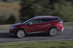 Picture of a driving 2017 Nissan Murano in Cayenne Red Metallic from a side perspective