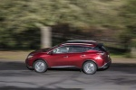 Picture of a driving 2017 Nissan Murano in Cayenne Red Metallic from a left side perspective