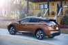 2018 Nissan Murano Platinum AWD in Pacific Sunset Metallic from a rear left view