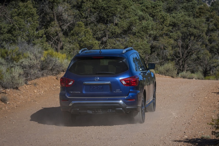 Driving 2018 Nissan Pathfinder Platinum 4WD in Caspian Blue from a rear right view
