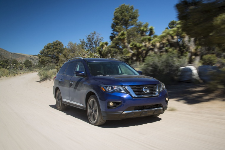 Picture of a driving 2020 Nissan Pathfinder Platinum 4WD in Caspian Blue Metallic from a front right three-quarter perspective