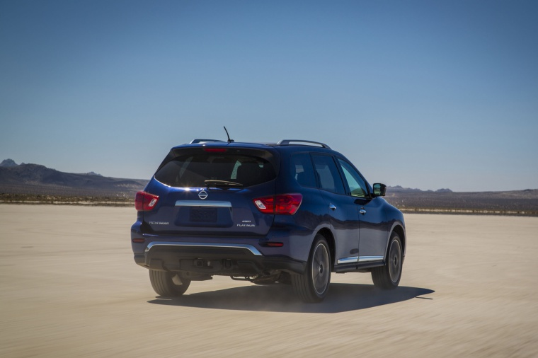 Picture of a driving 2020 Nissan Pathfinder Platinum 4WD in Caspian Blue Metallic from a rear right perspective