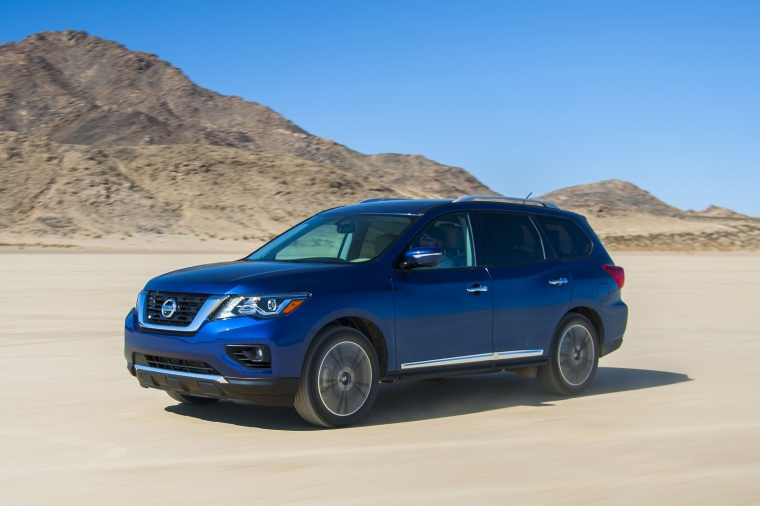 Picture of a driving 2020 Nissan Pathfinder Platinum 4WD in Caspian Blue Metallic from a front left three-quarter perspective