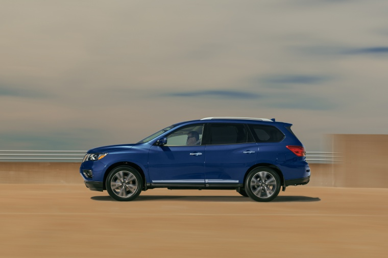 Picture of a driving 2020 Nissan Pathfinder Platinum 4WD in Caspian Blue Metallic from a side perspective