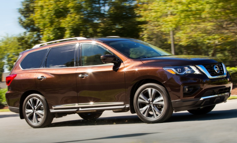 Picture of a driving 2020 Nissan Pathfinder Platinum 4WD in Mocha Almond Pearl from a front right three-quarter perspective