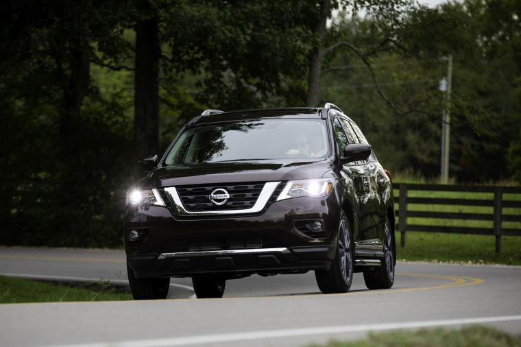 Picture of a driving 2020 Nissan Pathfinder Platinum 4WD in Mocha Almond Pearl from a front left perspective
