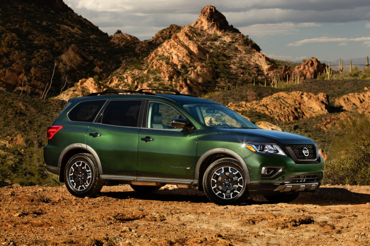 Picture of a 2020 Nissan Pathfinder SL Rock Creek Edition 4WD in Midnight Pine Metallic from a front right three-quarter perspective