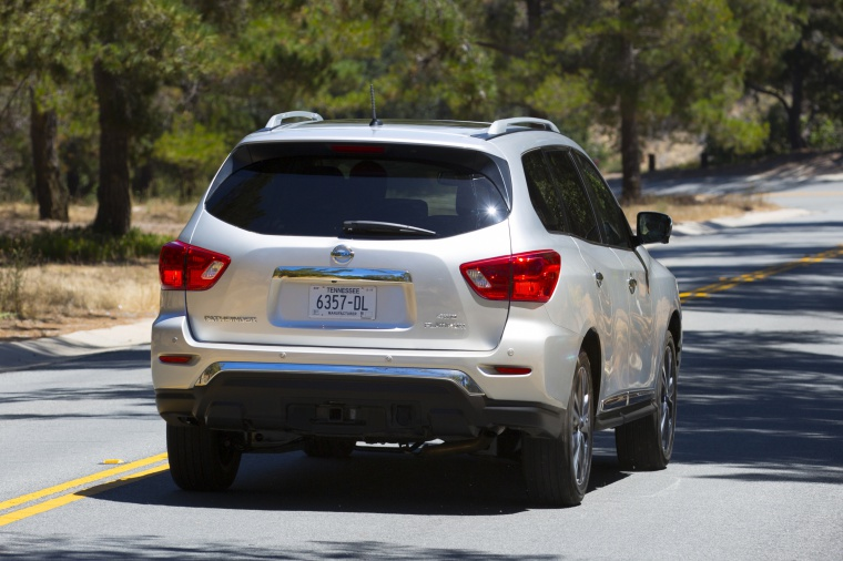 Picture of a driving 2020 Nissan Pathfinder Platinum 4WD in Brilliant Silver Metallic from a rear right perspective