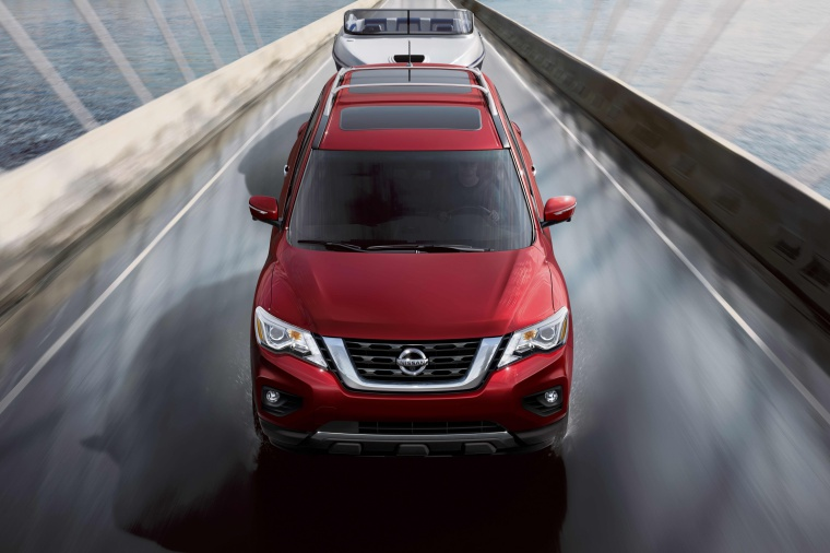 Picture of a driving 2020 Nissan Pathfinder Platinum 4WD in Scarlet Ember Tintcoat from a frontal perspective