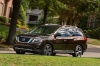 Picture of a driving 2020 Nissan Pathfinder Platinum 4WD in Mocha Almond Pearl from a front left three-quarter perspective