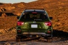 Picture of a 2020 Nissan Pathfinder SL Rock Creek Edition 4WD in Midnight Pine Metallic from a rear perspective