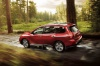Picture of a driving 2020 Nissan Pathfinder Platinum 4WD in Scarlet Ember Tintcoat from a rear left three-quarter perspective