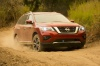 Picture of a driving 2020 Nissan Pathfinder Platinum 4WD in Scarlet Ember Tintcoat from a front right three-quarter perspective