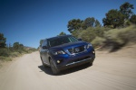 Picture of a driving 2020 Nissan Pathfinder Platinum 4WD in Caspian Blue Metallic from a front right perspective