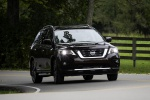 Picture of a driving 2020 Nissan Pathfinder Platinum 4WD in Mocha Almond Pearl from a front right perspective