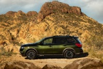 Picture of a 2020 Nissan Pathfinder SL Rock Creek Edition 4WD in Midnight Pine Metallic from a left side perspective