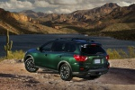 Picture of a 2020 Nissan Pathfinder SL Rock Creek Edition 4WD in Midnight Pine Metallic from a rear left three-quarter perspective