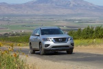 Picture of a driving 2020 Nissan Pathfinder Platinum 4WD in Brilliant Silver Metallic from a front right perspective