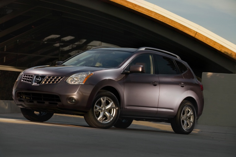 2010 Nissan Rogue in Iridium Graphite Metallic from a front left three-quarter view