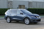 Picture of a 2014 Nissan Rogue SL AWD in Graphite Blue from a front right three-quarter perspective