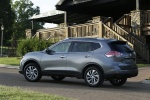 Picture of a 2014 Nissan Rogue SL AWD in Graphite Blue from a rear left three-quarter perspective