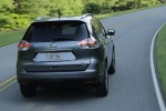 Picture of a driving 2014 Nissan Rogue SL AWD in Graphite Blue from a rear right perspective