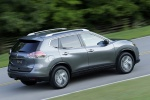 Picture of a driving 2014 Nissan Rogue SL AWD in Graphite Blue from a rear right three-quarter perspective
