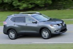 Picture of a driving 2014 Nissan Rogue SL AWD in Graphite Blue from a front right three-quarter perspective