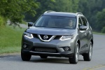 Picture of a driving 2014 Nissan Rogue SL AWD in Graphite Blue from a front left perspective