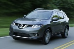 Picture of a driving 2014 Nissan Rogue SL AWD in Graphite Blue from a front left three-quarter perspective