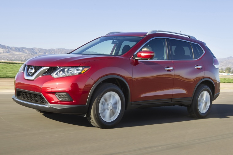 Driving 2016 Nissan Rogue SL AWD in Cayenne Red from a front left three-quarter view