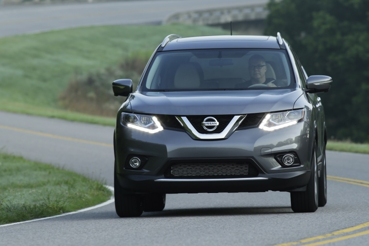 Picture of a driving 2016 Nissan Rogue SL AWD in Arctic Blue Metallic from a frontal perspective