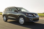 Picture of a driving 2016 Nissan Rogue SL AWD in Magnetic Black from a front right three-quarter perspective